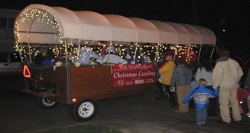 Image of caroling wagonload in a previiou year.
